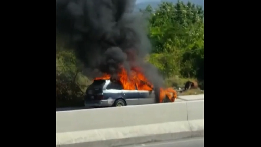 The Toyota Corolla is engulfed in flames along Marcus Garvey Drive on Thursday afternoon.
