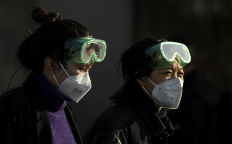 Des voyageurs à la gare de Pékin le 3 février 2020 afp.com - NOEL CELIS