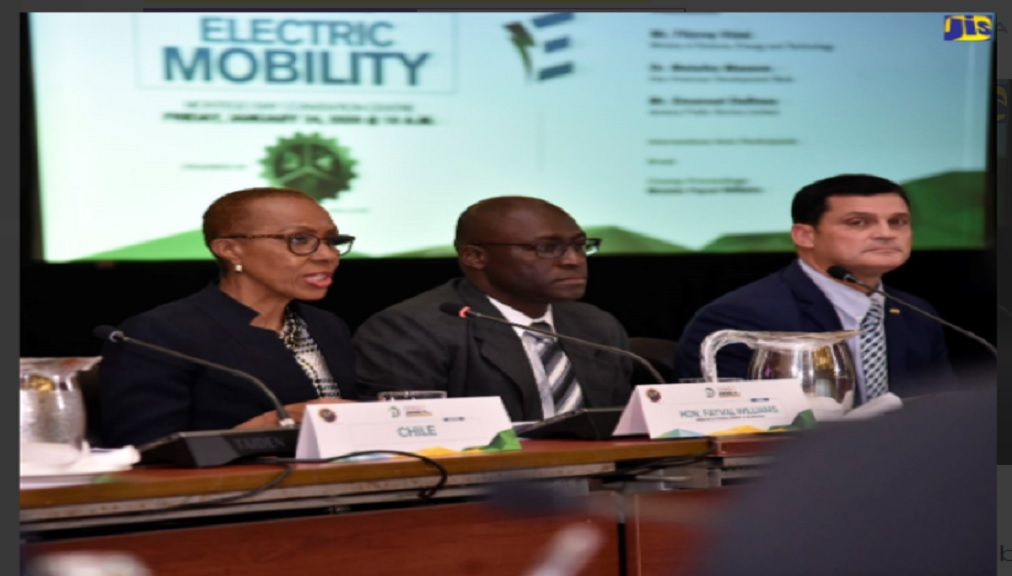 Minister of Science, Energy and Technology, Fayval Williams (left) speaking at a recent energy round table hosted by the Ministry in Montego Bay, St. James. Listening are Principal Director in the Ministry, Fitzroy Vidal (centre); and President and Chief Executive Officer (CEO) of the Jamaica Public Service Company (JPS), Emanuel DaRosa.