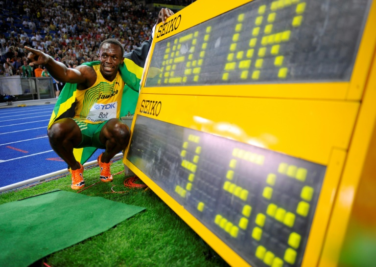 Usain Bolt of Jamaica celebrates winning the gold medal in the men's 100m with a world record of 9.58 seconds at the 12th IAAF World Championships in Athletics at the Olympic Stadium in Berlin on August 16, 2009.