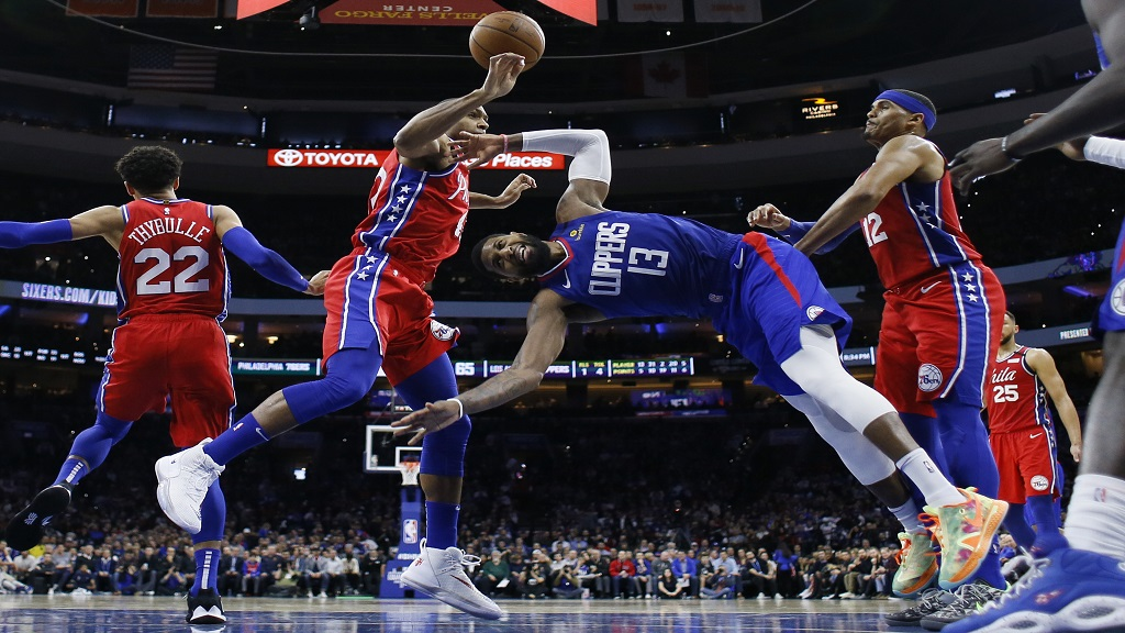 Los Angeles Clippers' Paul George (13) cannot get a shot past Philadelphia 76ers' Al Horford (42) Tobias Harris (12) and Matisse Thybulle (22) during the second half of an NBA basketball game, Tuesday, Feb. 11, 2020, in Philadelphia. (AP Photo/Matt Slocum).