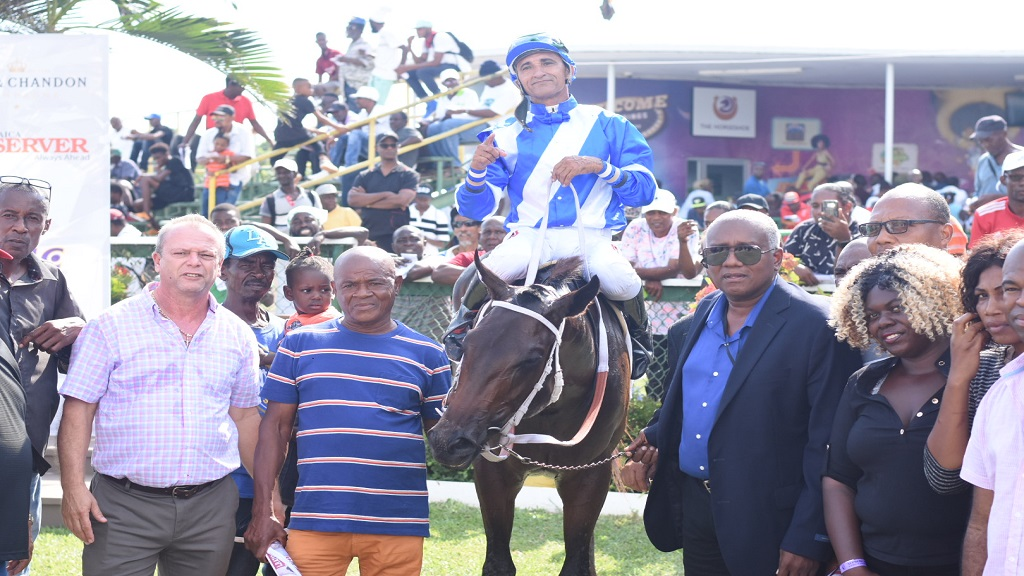 WOW WOW (Ameth Robles) poses in the winners' enclosure with connections including trainer Gary Subratie (left) and owner Michael Bernard (3rd left). (PHOTO: Marlon Reid).