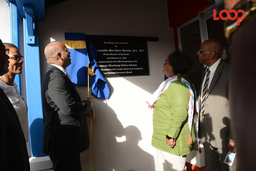 Attorney General, Dale Marshall and Prime Minister Mia Mottley unveil the plaque at the opening of the Worthing/Hastings Police Station.