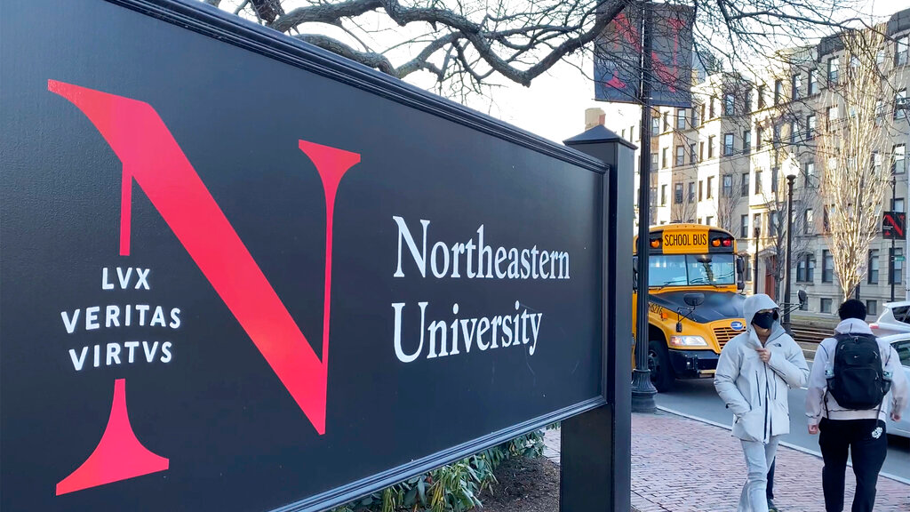 In this January 31, 2019 photo, students walk on the Northeastern University campus in Boston. As concerns about China's virus outbreak spread, universities all over the world are scrambling to assess the risks to their programs. (AP Photo/Rodrique Ngowi)