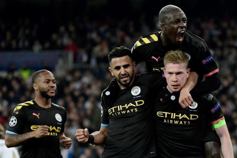 La joie des joueurs de Manchester City après le penalty réussi par Kevin de Bruyne face au Real, le 26 février 2020 à Madrid