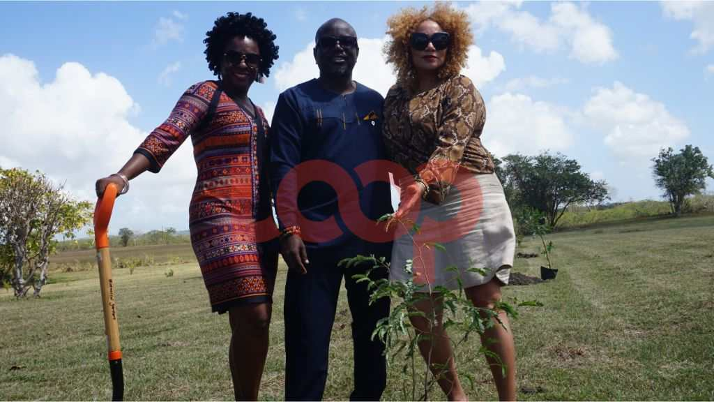 Ghana's Tourism CEO Akwasi Agyeman (C) Poses with Director of the BTMI Petra Roach as they planted their tree for the Million Trees in 2020 project for We Gatherin'