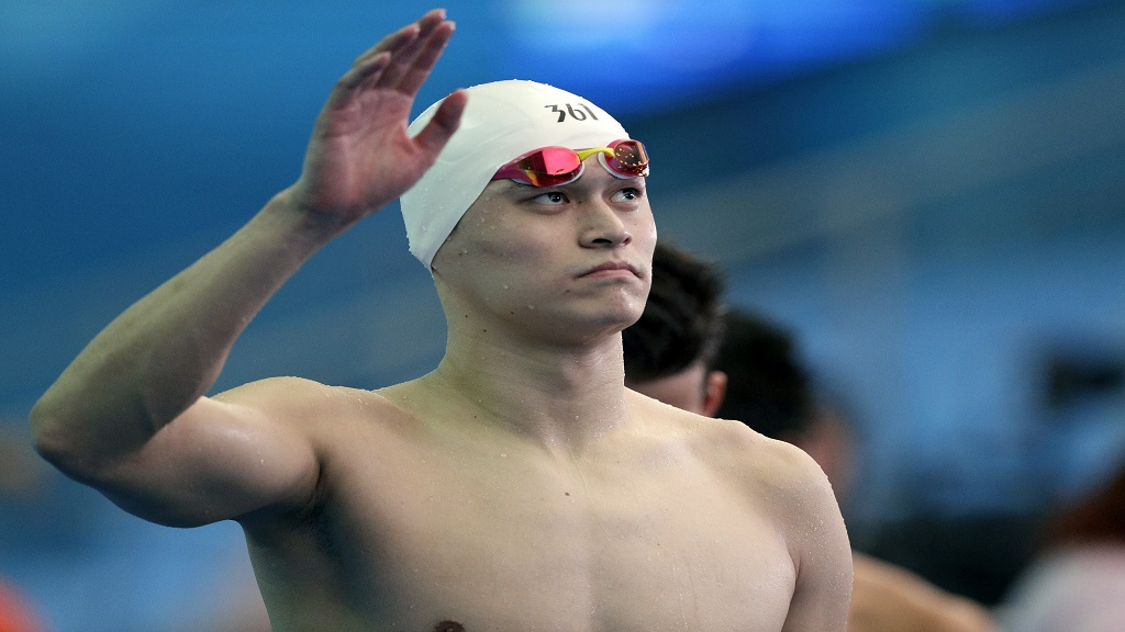 In this Friday, July 26, 2019 file photo, China's Sun Yang waves following the men's 4x200m freestyle relay heats at the World Swimming Championships in Gwangju, South Korea.