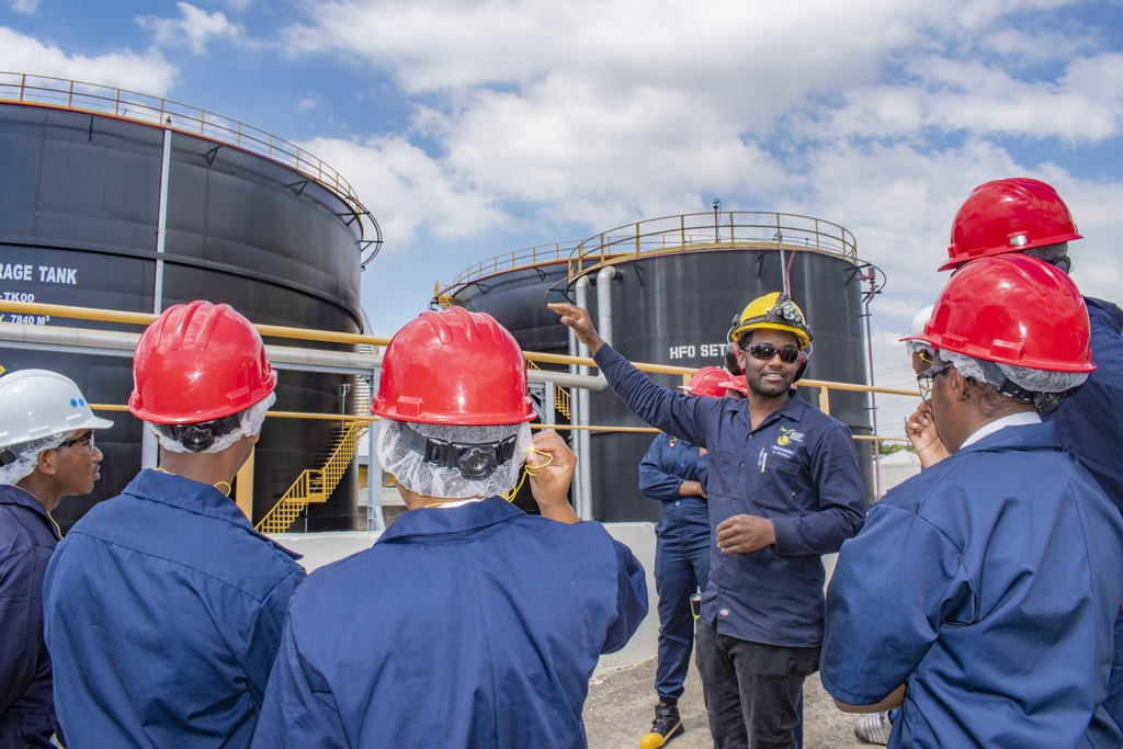 Grade 11 students of St Mary High School pay keen attention to Instrumentation & Electrical Technician, Odane Powell as he facilitates their very first tour of a power plant in Jamaica.