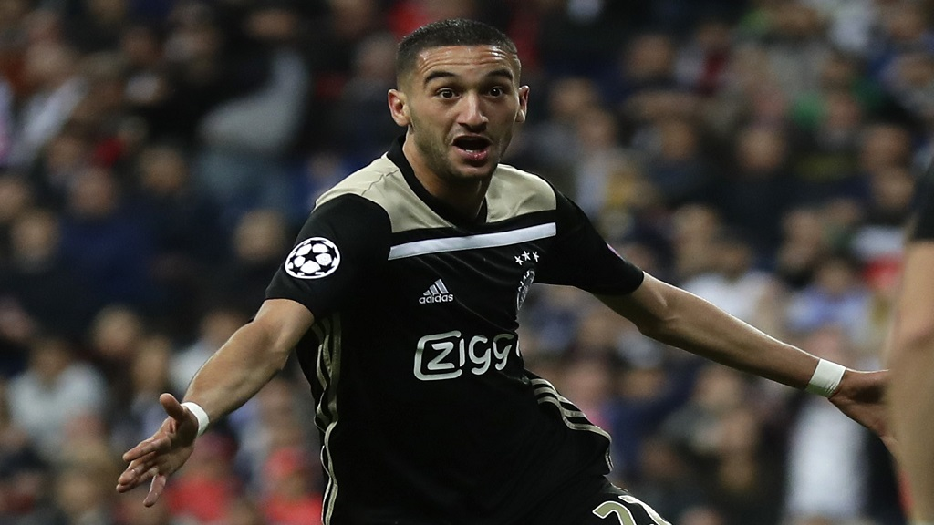 In this Tuesday, March 5, 2019 file photo, Ajax's Hakim Ziyech celebrates scoring the opening goal during their Champions League football match against Real Madrid at the Santiago Bernabeu stadium in Madrid, Spain.  (AP Photo/Manu Fernandez, file).