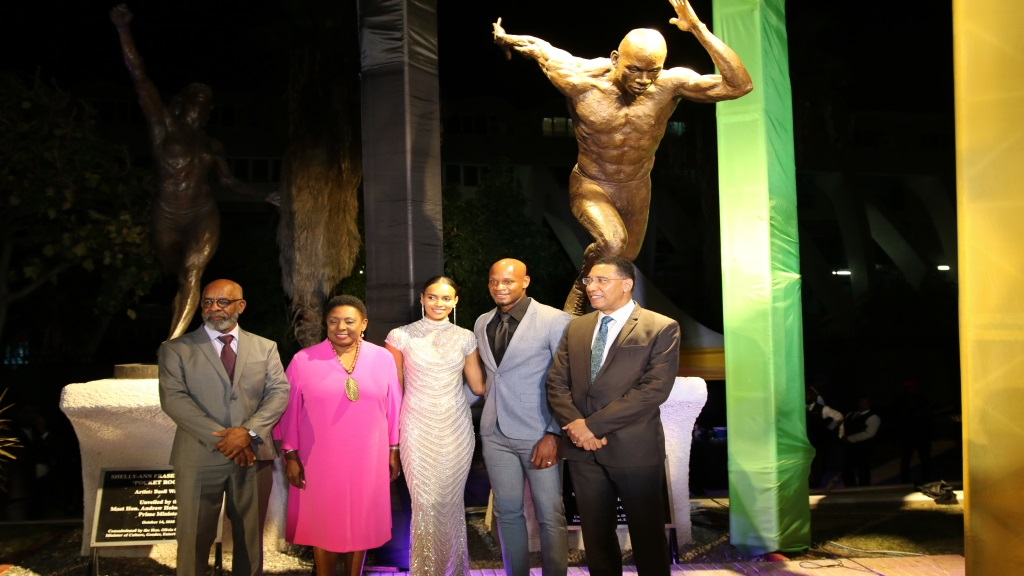 (From right) Prime Minister Andrew Holness, Asafa Powell  and wife Alyshia, Sports Minister Olivia Grange and sculptor Basil Watson stand in front of the sprint icon newly unveiled statue at Independence Park on Sunday, September 9, 2020. (PHOTOS: Llewelyn Wynter).