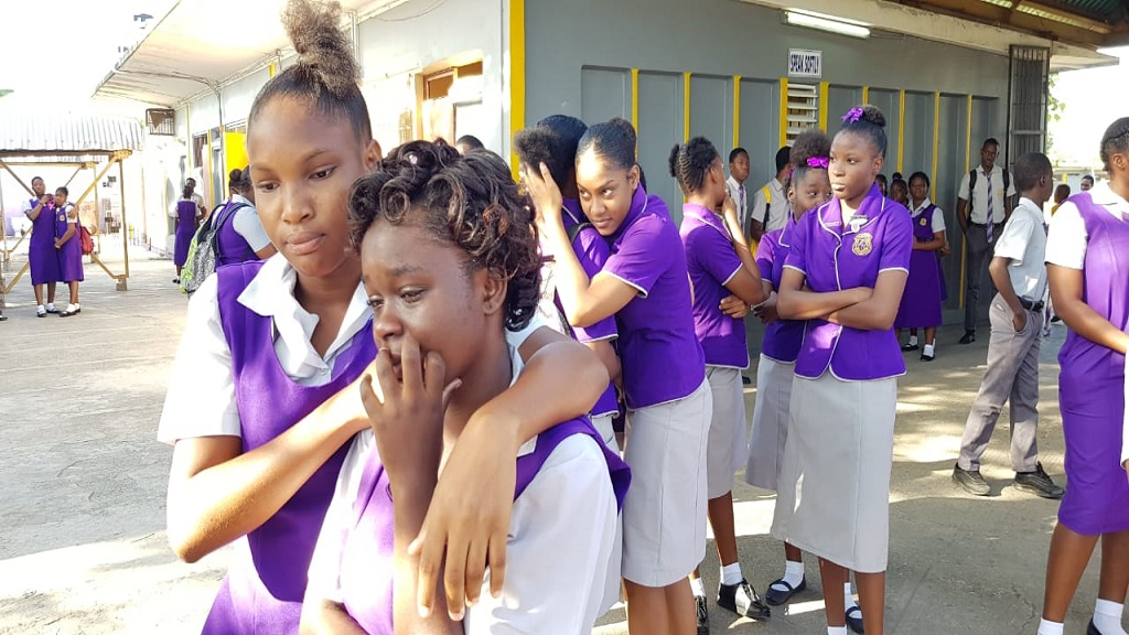 Ascot High School students comfort each other following news of the murder of grade 10 student Jaheim Palmer.