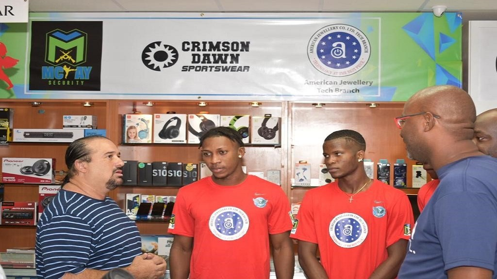 Jason McKay (left) CEO, McKay Security, speaks with Duhaney Park Football Club players Kemar Reid and Odare Wilson and club President Darrington Ferguson (right), during a press briefing to announce sponsorship at American Jewellery Tech Branch, Mall Plaza, on Constant Spring Road earlier this week.