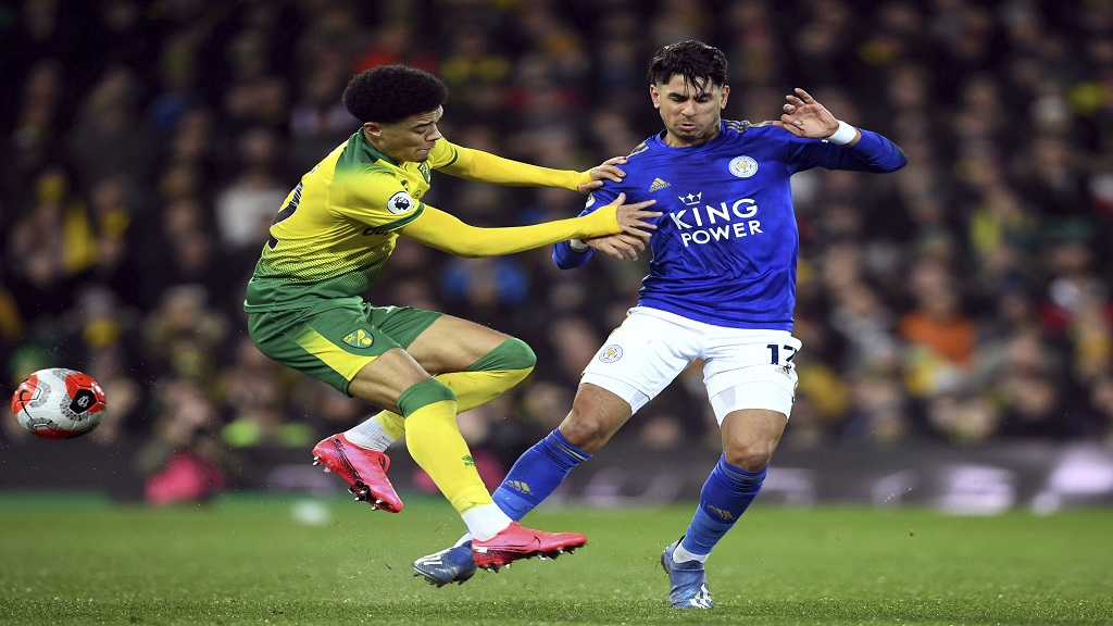 Norwich City's Jamal Lewis, left, and Leicester City's Ayoze Perez battle for the ball during the English Premier League football match at Carrow Road, Norwich, Friday Feb. 28, 2020. (Joe Giddens/PA via AP).