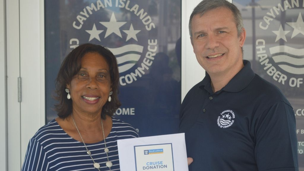 Marjorie Scott receiving her 7-day cruise vacation for two from Chamber CEO, Wil Pineau