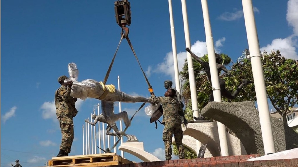 Two soldiers from the Jamaica Defence Force (JDF) help to mount the statue of Asafa Powell inside Statue Park at the National Stadium in Kingston. The unveiling of the statue will take place at a special ceremony on Sunday, February 9 at the venue.