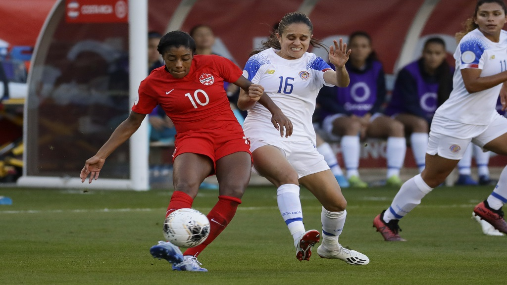 Canada defender Ashley Lawrence, left, kicks the ball past Costa Rica midfielder Katherine Alvarado during the first half of a Concacaf Women's Olympic qualifying football match Friday, Feb. 7, 2020, in Carson, Calif. (AP Photo/Chris Carlson).
