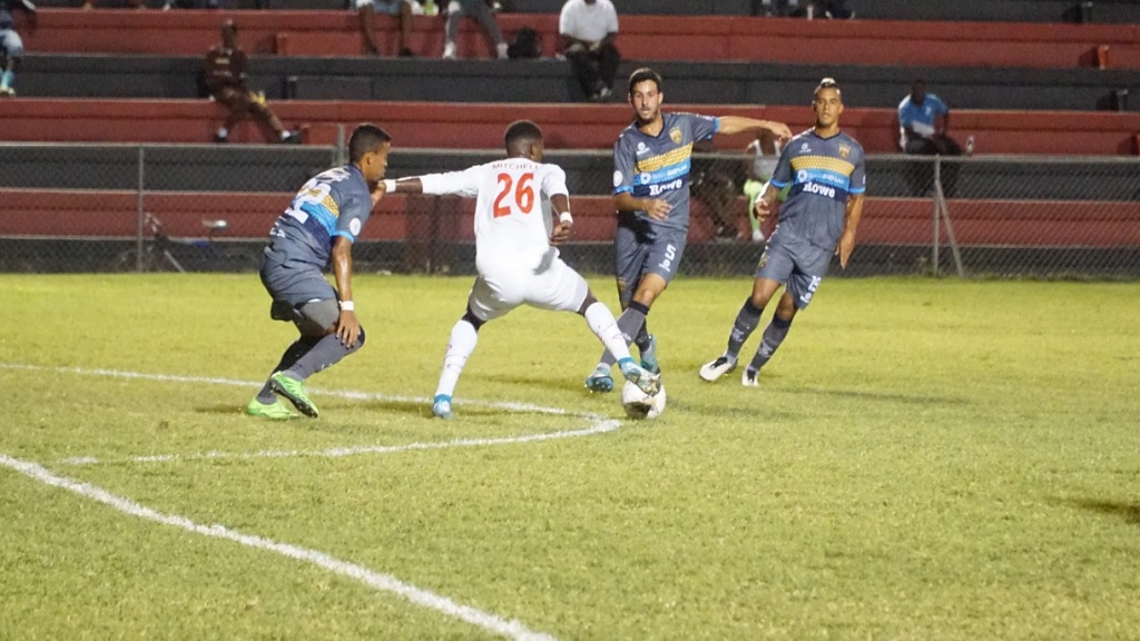 Portmore United's Revaldo Mitchell takes on Ernesto Trinidad (left) and Josep Diez (right) of Club Atletico Pantoja of the Dominican Republic in their Group B fixture of the Flow Concacaf Caribbean Club Championship on Wednesday, February 5, 2020 at the Anthony Spaulding Sports Complex in Kington, Jamaica. (PHOTO: Concacaf).