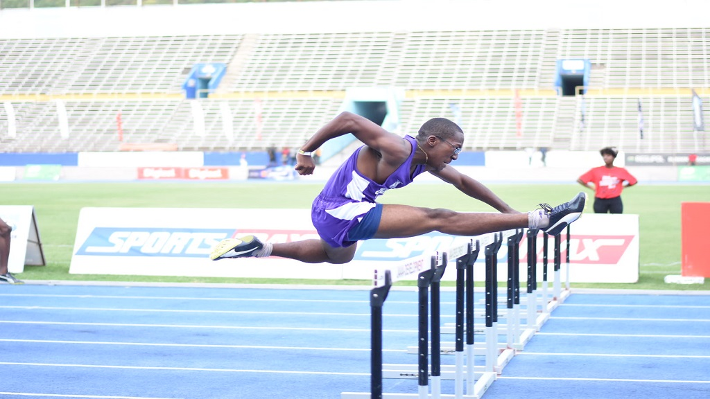Kingston College's Ra'John Gray powers home to a meet record victory in the Boys' Class 3 100m hurdles final at the Digicel/Anthrick Corporate Area Championships at the National Stadium on Saturday, February 15, 2020. (PHOTOS: Marlon Reid).