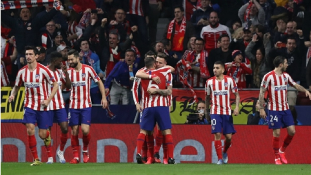 Atletico Madrid players celebrate.
