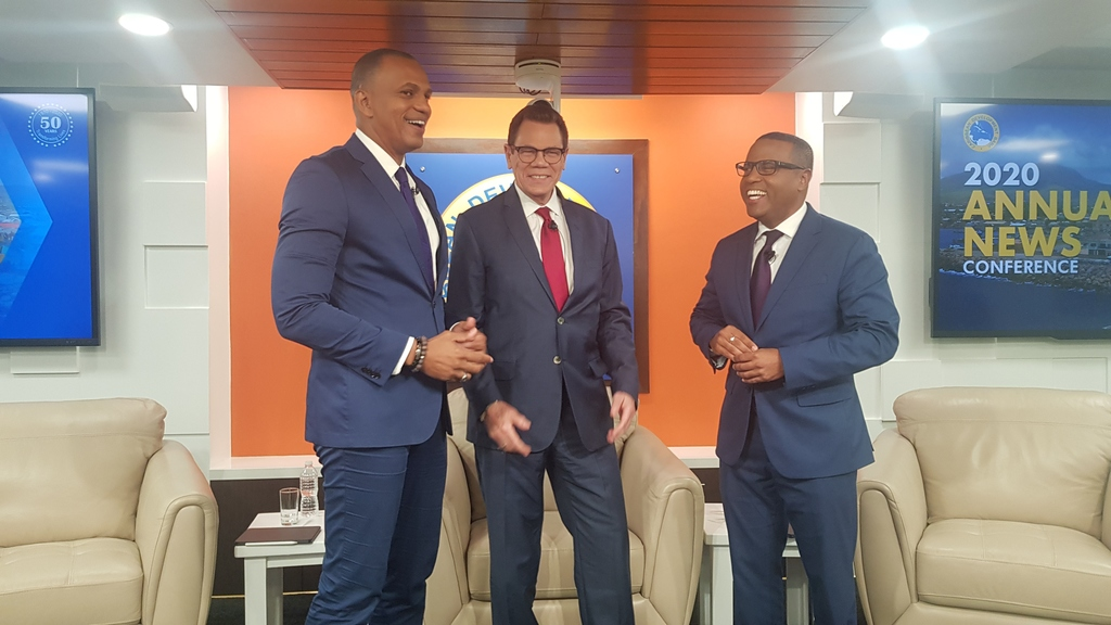 President of the CDB Dr William Warren Smith in centre with Daniel Best, Director of Projects (l) and Justin Ram, Director of Economics.