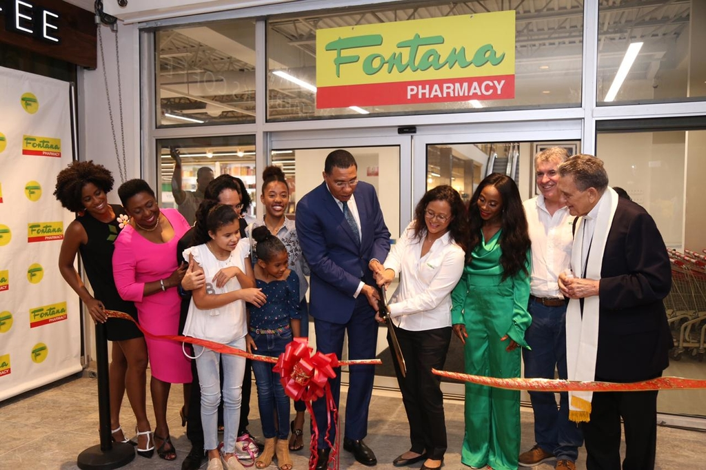 Prime Minister Andrew Holness (centre) joined Fontana executives, including CEO Anne Chang and chairman Kevin O'Brien Chang on Thursday for a ribbon-cutting ceremony to officially open the company's new Waterloo Square branch. Also sharing in the moment is Olympic and World Champion Shelly-Ann Fraser-Pryce.