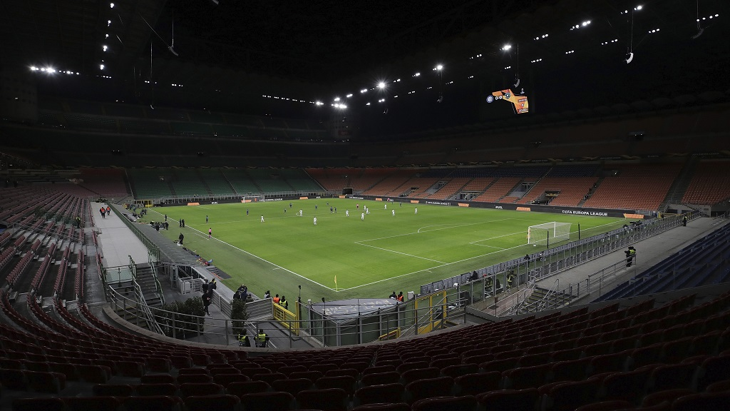 A general view inside the empty San Siro stadium in Milan, Italy during the Europa League round of 32 second leg football match between Inter Milan and Ludogorets on Thursday Feb. 27, 2020. Inter beat Ludogorets 2-1 in an empty stadium as a precaution because of the virus outbreak in Italy. (Emilio Andreoli, UEFA via AP).
