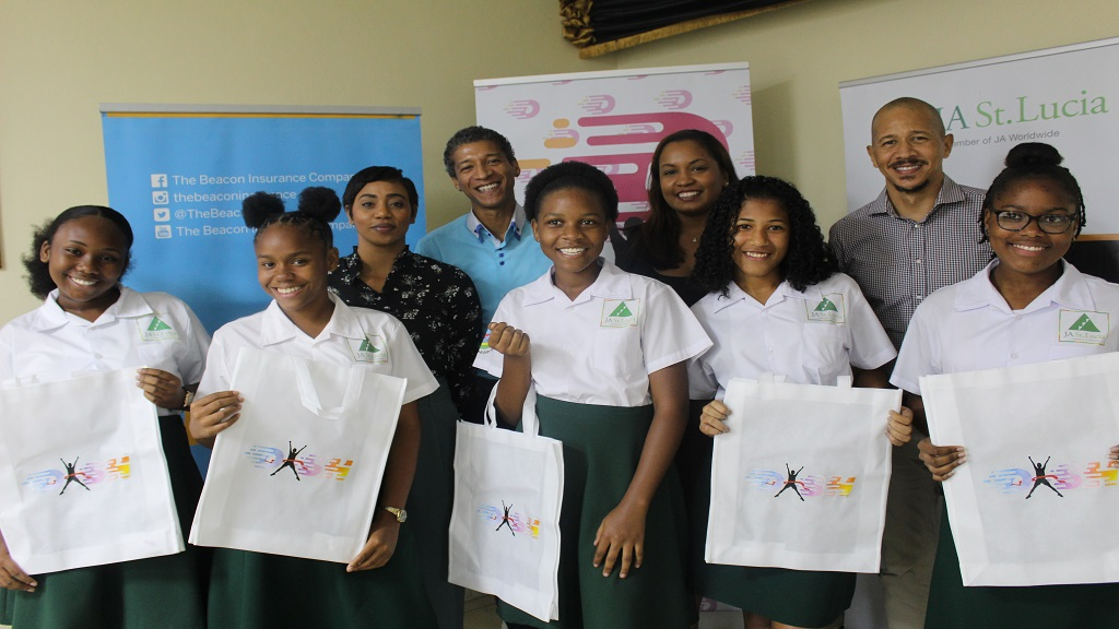 DASH directors Robberta Rose, Akim Larcher, Dione Marshall and Aberra Larcher with members of the Junior Achievement of St Lucia from Entrepot Secondary School.