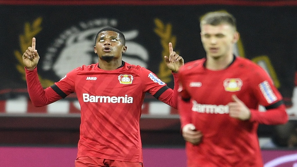 Leverkusen's Leon Bailey, left, celebrates after scoring his side goal during the German Bundesliga match between Bayer Leverkusen and Borussia Dortmund in Leverkusen, Germany, Saturday, February 8, 2020. (AP Photo/Martin Meissner)