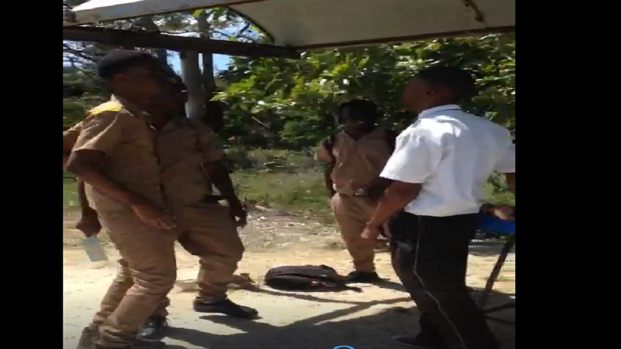 File photo of Green Island High School students and a bus operator in the Hanover town back in March 2018 just before a major fracas occurred, which resulted in charges being laid by the police against a number of the students.