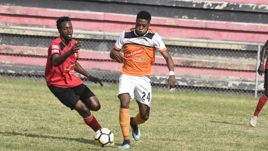 File photo shows a Red Stripe Premier League match between Arnett Gardens (red shirt) and Tivoli Gardens.