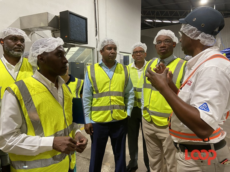 Minister of Water Resources, Wilfred Abrahams accompanied by officials from the Barbados Water Authority touring the Barbados Bottling Company.