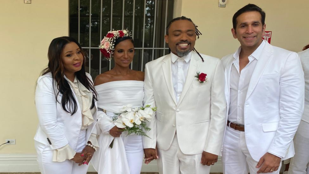 Attorney General Faris Al-Rawi (right) was a guest at soca artiste Machel Montano's wedding at the Red House on Valentine's Day.