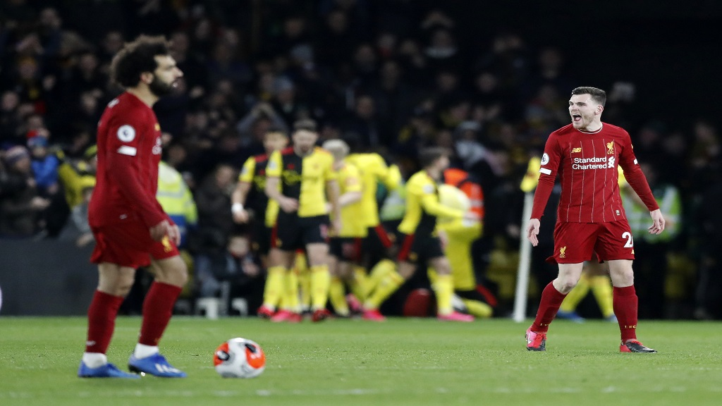 Liverpool's Andrew Robertson, right, and his teammate Mohamed Salah, react after Watford's Troy Deeney scores his side's third goal during their English Premier League football match at Vicarage Road stadium, in Watford, England, Saturday, Feb. 29, 2020. (AP Photo/Alastair Grant).