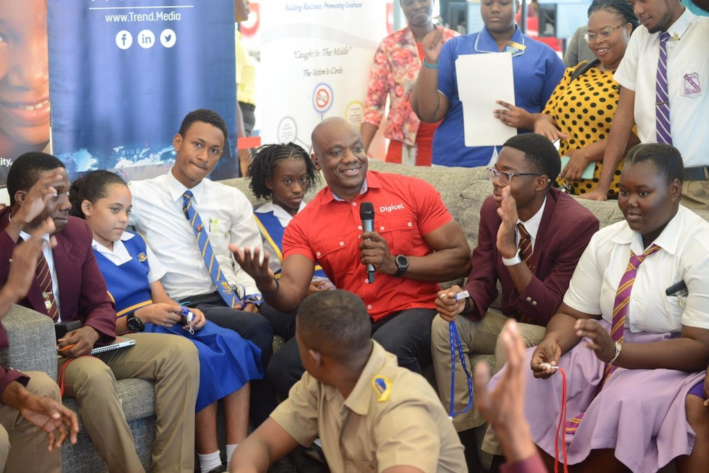 Public Relations and Communications Manager at Digicel, Elon Parkinson, was surrounded by students of several high schools in Kingston during a lively discussion about online safety for young people during Safer Internet Day activities on Tuesday.