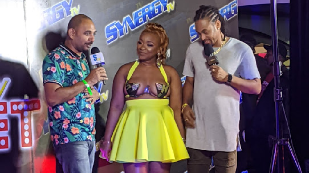 Radio DJ Kevin Dunning, aka Linx, and fiancee Josanne James are interviewed by Synergy TV's Stephan Reis at Army Fete on Valentine's Day. Photo by Darlisa Ghouralal.