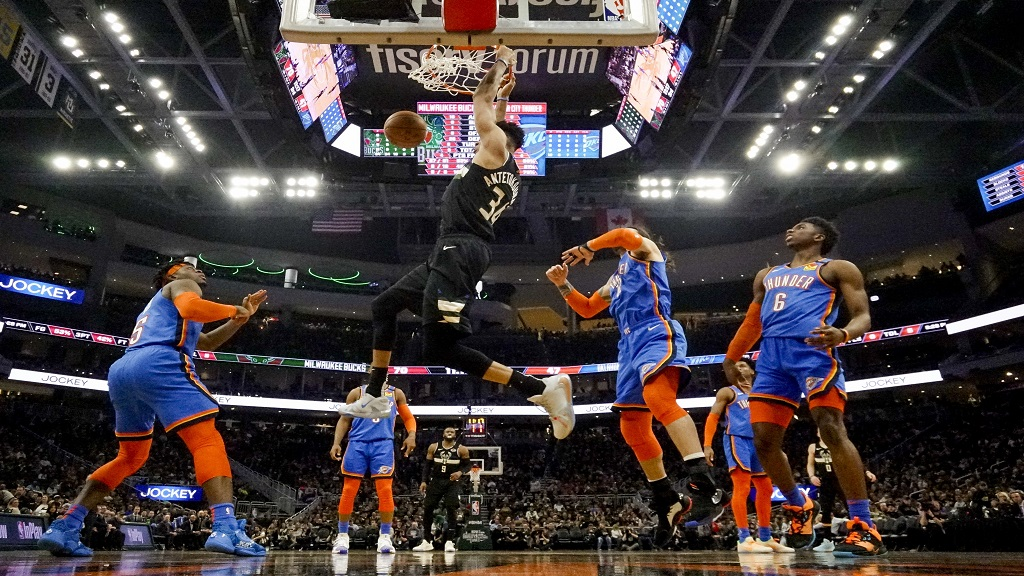 Milwaukee Bucks' Giannis Antetokounmpo dunks during the second half of an NBA basketball game against the Oklahoma City Thunder Friday, Feb. 28, 2020, in Milwaukee. (AP Photo/Morry Gash).