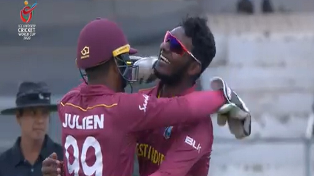 West Indies players, right-arm off-spinner Matthew Patrick (right) and Leonardo Julien, celebrate the wicket of Australia's Ollie Davies during the fifth-place playoff game of the 2020 Under 19 World Cup in South Africa on Friday, February 7. The game was eventually washed out.