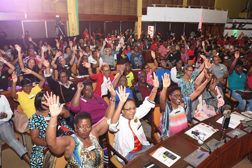 A section of the over 900 transformational leaders and 'leaders in the making' is seen here raising their hands in commitment to transforming their lives and communities using the tools and principles shared during the transformational conference hosted by the JMMB Joan Duncan Foundation, earlier this month.