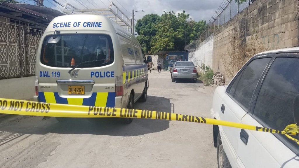 A section of the road in Cassia Park, St Andrew is cordoned off following the fatal shooting of two men there on Thursday.