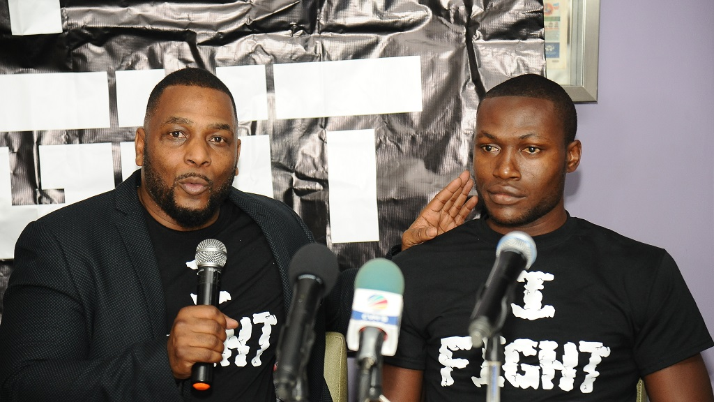 Head of I-Fight Promotion Chris Joy (left) speaks at the launch of a five-bout boxing card at Tracks & Records in Kingston on Tuesday, February 11, 2020. Jamaican Jermaine Bowen, one of the boxers on the card, listens. The fight card takes place on Saturday at Jamaica College.