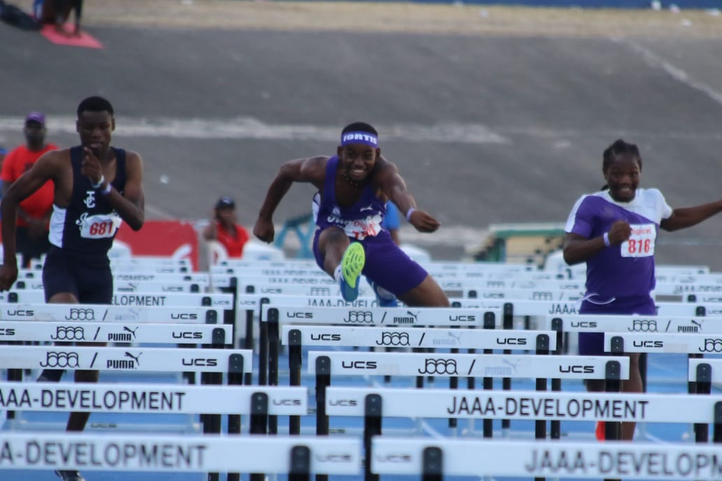 Ra'John Gray (centre) of Kingston College (KC) on his way to victory in the  Boys' Class 3 100m hurdles final at the Youngster Goldsmith Athletic Classics at the National Stadium on Saturday, February 2, 2020.  Gray won in a meet record 13.12 seconds. (PHOTOS: Llewelyn Wynter).