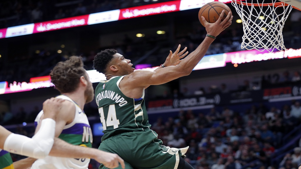 Milwaukee Bucks forward Giannis Antetokounmpo (34) goes to the basket in front of New Orleans Pelicans forward Nicolo Melli in the second half of an NBA basketball game in New Orleans, Tuesday, Feb. 4, 2020. (AP Photo/Gerald Herbert).