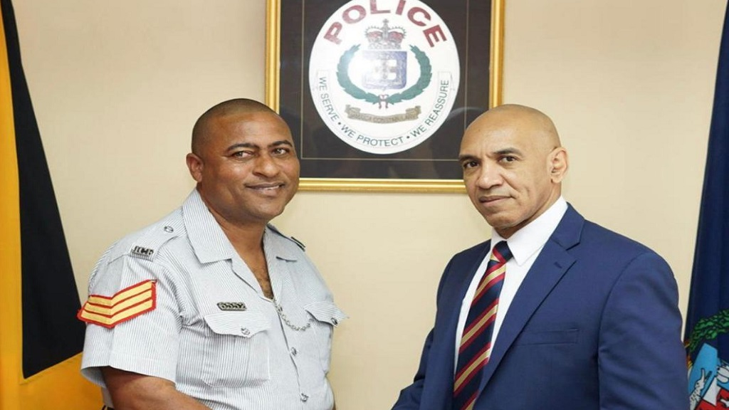 Sergeant Andrew Palmer meets Commissioner of Police, Major Antony Anderson..