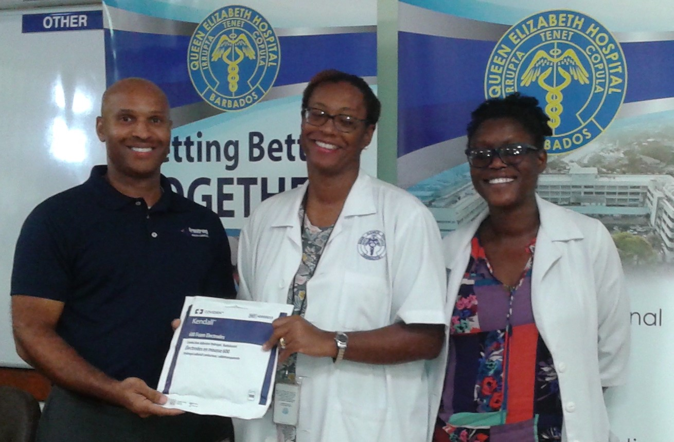 (L-R) Anthony Bryan, Armstrong Health Care Inc business development manager, presenting donated medical equipment to Dr Joanne Bradford, QEH head of Accident and Emergency department, and Dr Shantel Young-Boyce, QEH senior registrar