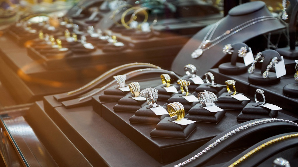 iStock photo of a luxury retail store window showcasing rings and necklaces.