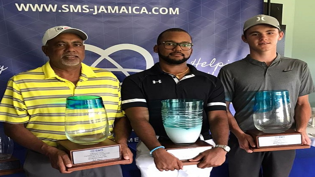William Knibb (centre) displays his trophy after winning the SMS Golf Classic at the Caymanas Golf Club last weekend. At left is Sean Morris, who finished third, while runner-up Rocco Lopez is at right.