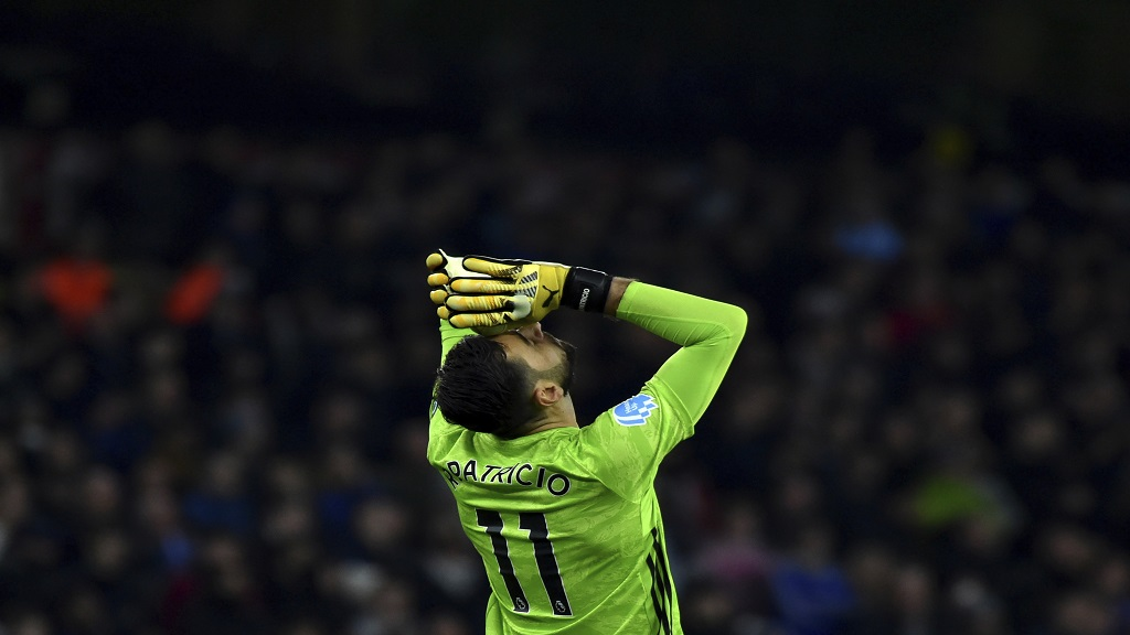 Wolverhampton Wanderers' goalkeeper Rui Patricio reacts during their English Premier League football match against Leicester City at the Molineux Stadium in Wolverhampton, England, Friday, Feb. 14, 2020. (AP Photo/Rui Vieira).