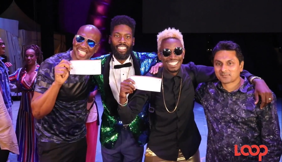 Neil 'Iwer' George (left), College Boy Jesse and a member of the ISM team (right) collect their prize cheques from ISM 2020 host, Sunny Blingg (centre)