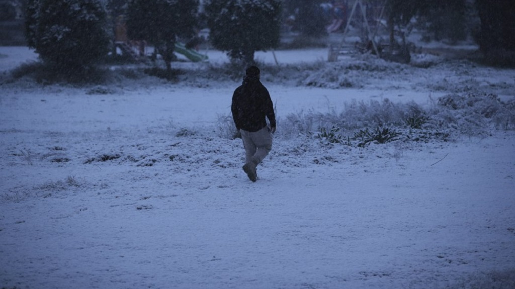 A man walks in a fresh snow in Baghdad, Iraq, Tuesday, Feb. 11, 2020. (AP Photo/Hadi Mizban)
