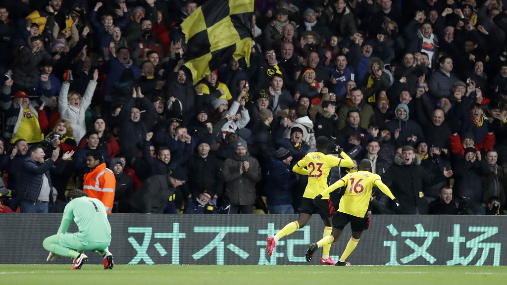 Watford's Ismaila Sarr, second right, celebrates after scoring his side's second goal during the English Premier League football match against Liverpool at Vicarage Road stadium, in Watford, England, Saturday, Feb. 29, 2020. (AP Photo/Alastair Grant).